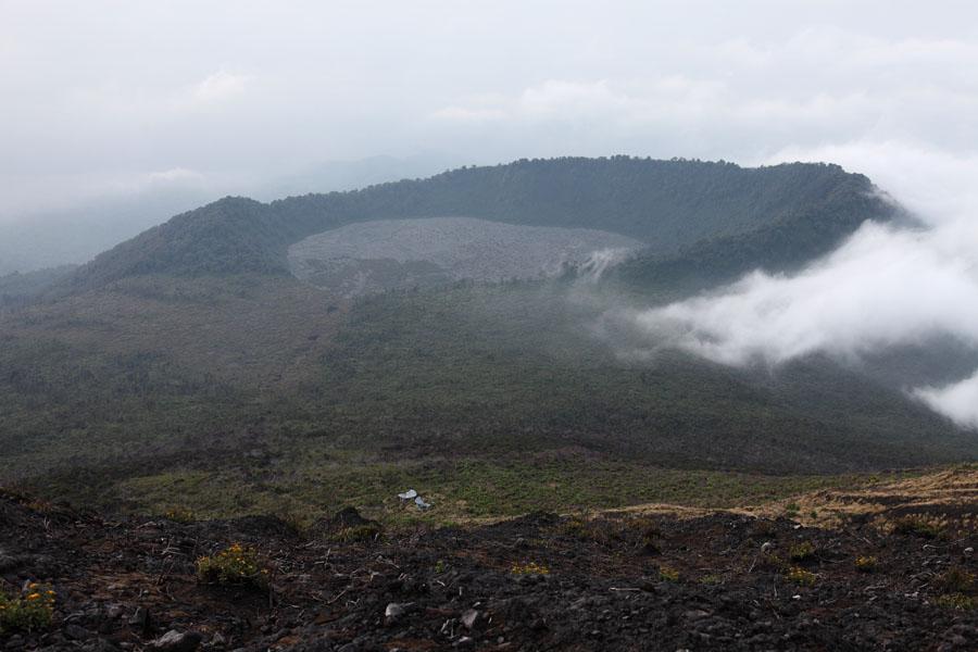 the next nyiragongo essay The slopes of nyamuragira rise gradually, in contrast to the adjacent steep-sided nyiragongo volcano to its se, thus extending far from the summit region this, is a further factor accounting for the unusual length of some of the lava flows emplaced by the volcano.