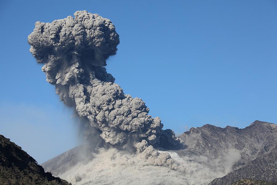Sakurajima Volcano Vulcanian Explosion Producing Large Ash Cloud Against Blue Sky